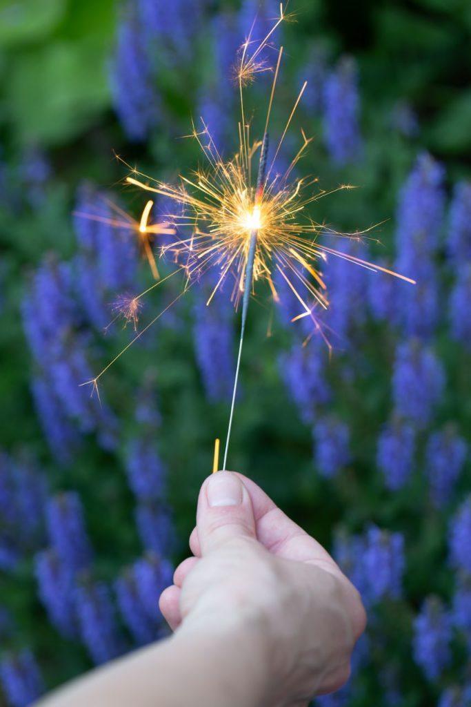 sparkler firework in hand