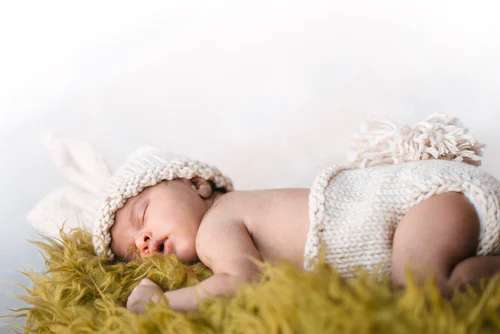 baby is sleeping deeply in photoshoot